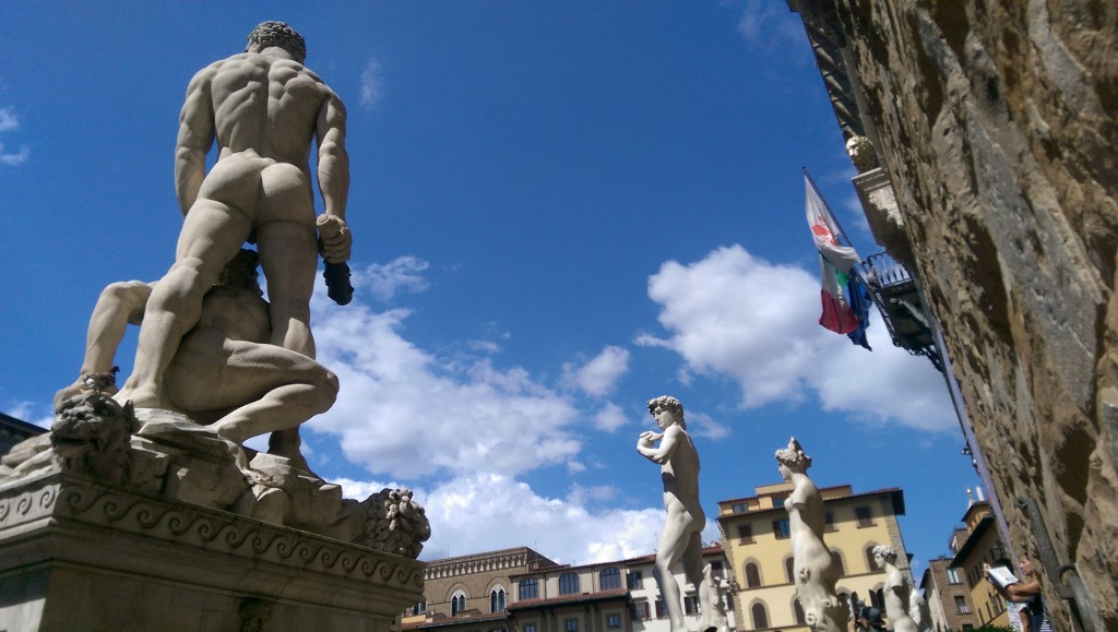 Entrance to the Palazzo Vecchio in Florence. In the middle there is replica of David sculpture.