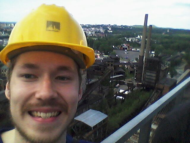 Antti, defying death, a top of an old steel mill, grinning