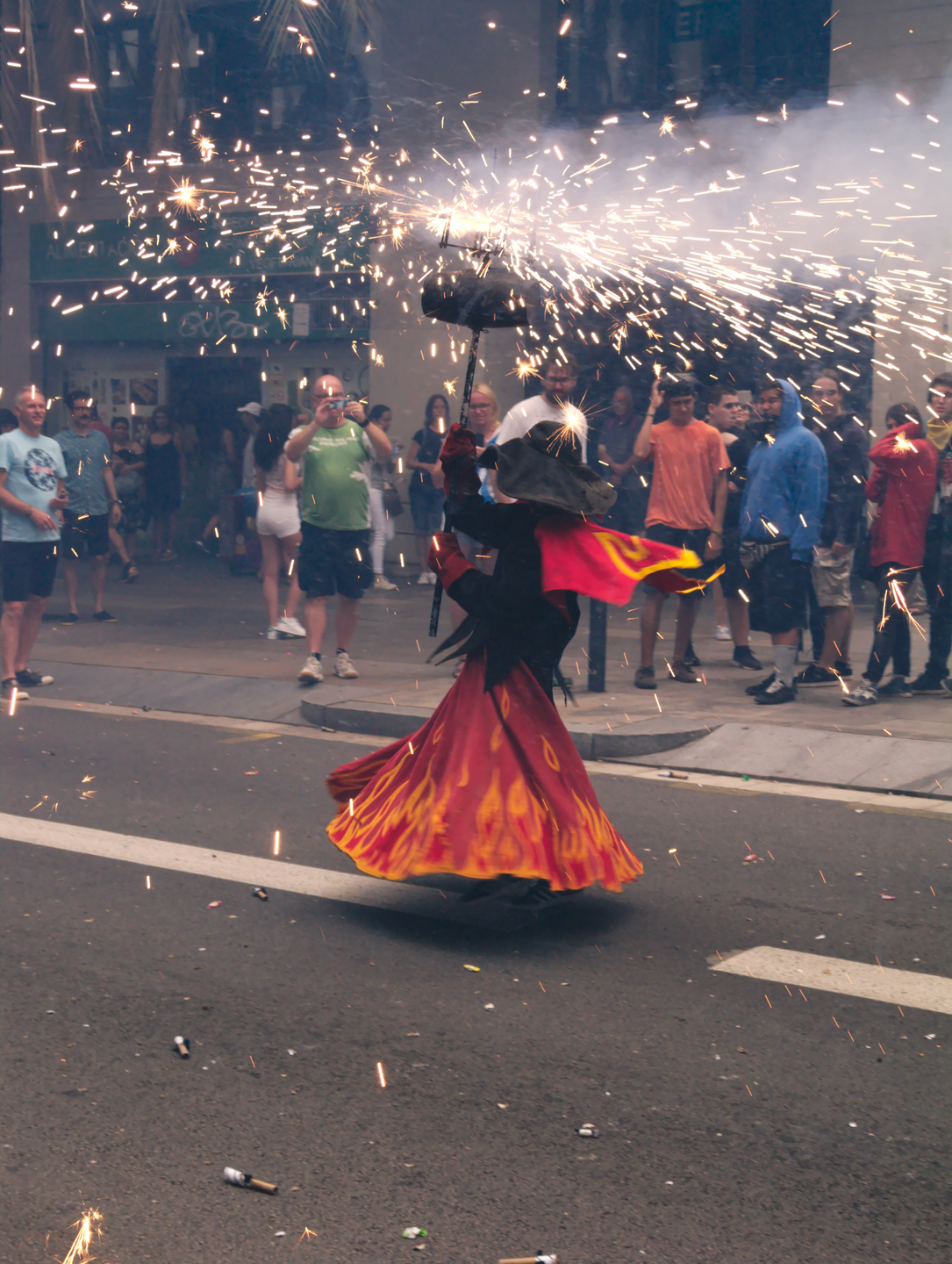 Image of a woman dancing with fireworks during the parade